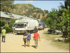 Aid trucks in East Timor