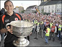 Tyrone's Brian Dooher with the Sam Maguire trophy