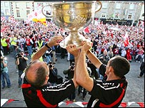 Mickey Harte and Brian Dooher hold the trophy aloft
