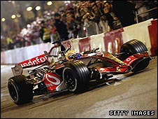 Lewis Hamilton in a McLaren during a night-time demonstration at Valencia last year