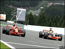 Lewis Hamilton (right) lets Kimi Raikkonen's Ferrari pass his McLaren on the Spa pit straight before re-passing him at the first corner