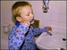 Child brushing teeth (generic)