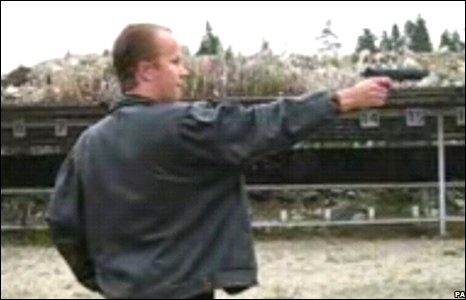 Image from a YouTube video of man firing a pistol