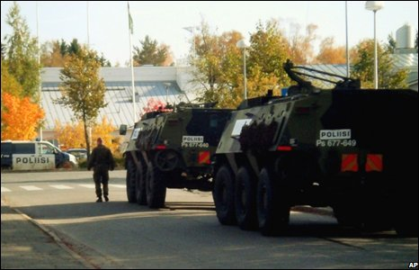 Police vehicles at the school in Kauhojoki, Western Finland, where 9 students were shot dead
