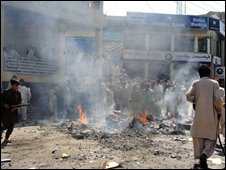 Pakistani protesters burn tyres on a road after police fired at the protesters in Mingora, the main city in Swat on September 23, 2008.