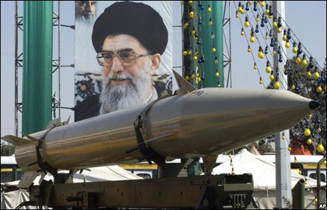 Missile in front of a poster of Ayatollah Ali Khamenei