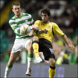 Rocco Quinn (right) grapples for the ball with Celtic's Lee Naylor