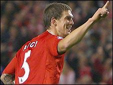 Liverpool defender Daniel Agger celebrates the opener against Crewe