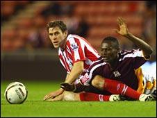 Sunderland's Daryl Murphy tackles Northampton's Abdul Osman