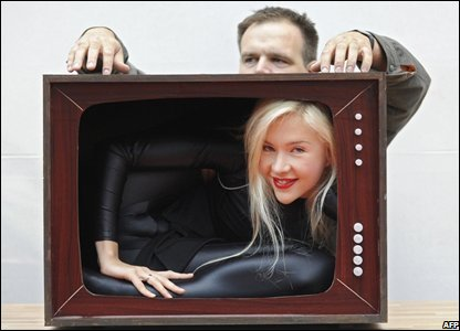 Contortionist Zlata inside the shell of a mock television set, Berlin ...