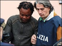 Patrick Lumumba, left, with police