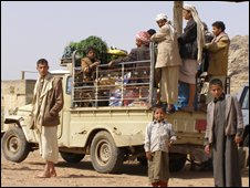 Yemeni men travelling by truck