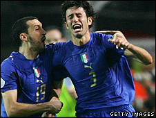 Italy's Fabio Grosso (right) celebrates World Cup goal, 2006