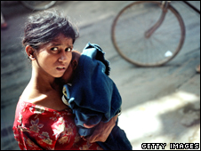 An Indian woman holds her baby