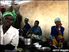 A group of people cook a meal in the Democratic Republic of Congo