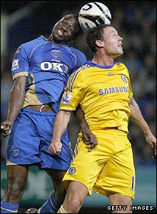 Portsmouth's John Utaka goes up against Wayne Bridge