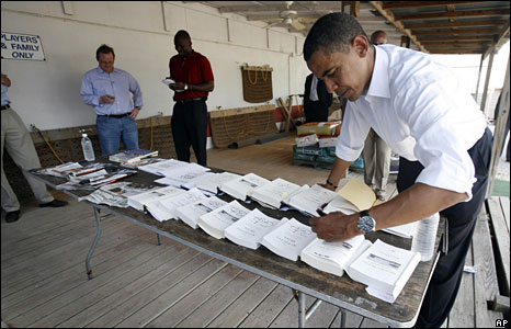 Barack Obama signs copies of his book 'The Audacity of Hope' after a campaign rally in Dunedin, Florida
