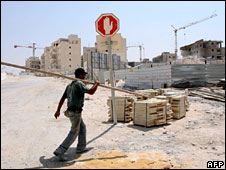 A labourer works in Maale Adumim, the largest Jewish settlement in the West Bank, on 27 August 2008