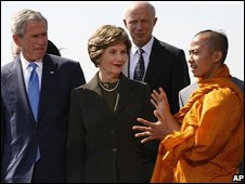 President Bush, left, and first lady Laura Bush, center, listen to Kovida U