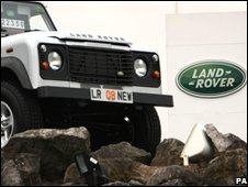 Land Rover car and sign
