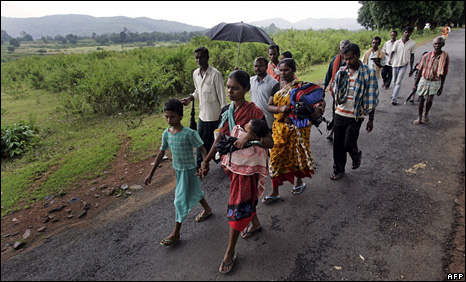Christians walking to relief camps after rioting in Kandhamal