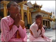 Nuns pray at Shwedagon Pagoda shrine in Rangoon, Burma, on Friday