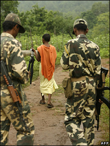 Security personnel watch over a Hindu