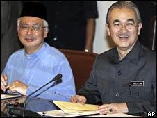 Malaysian Prime Minister Abdullah Badawi, right, with his deputy Najib Razak