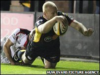 Wing Richard Fussell squeezes in for the Dragons' try