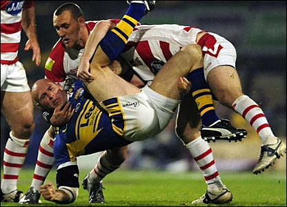 It's a tight first-half at Headingley as both sides give little ground - here Wigan get to grips with Keith Senior