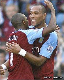 John Carew celebrates scoring Villa's second goal with Ashley Young