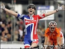 Great Britain's Nicole Cooke celebrates winning the women's road race