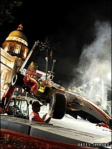 Giancarlo Fisichella's Force India car is lifted off the track