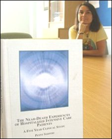 Penny Sartori with her book