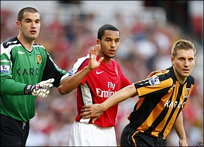 Boaz Myhill and Adam Dawson, Hull City; Theo Walcott, Arsenal