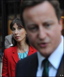 David Cameron with wife Samantha behind