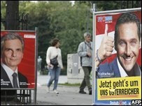 Posters showing the Leader of the far-right Fredom Party Heinz-Christian Strache (R) and Social Democrat chairman Werner Faymann.