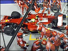 Felipe Massa pulls away from the pits with the Ferrari's refuelling hose still attached during the Singapore Grand Prix