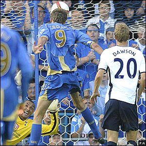 Peter Crouch, Portsmouth, scores