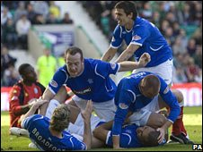 Rangers players celebrate against Hibs