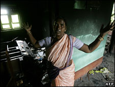 A Christian villager in her house which was burnt down in Orissa