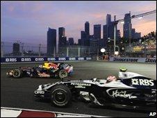 F1 cars speed pace Singapore's skyline