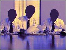 A group of faceless men around a boardroom table