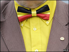 A man wears a bow tie with the Belgian national colours. File photo