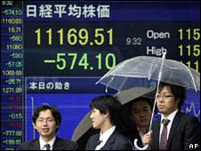 Screens indicate sharp losses on the Tokyo stock exchange, 30 September 2008