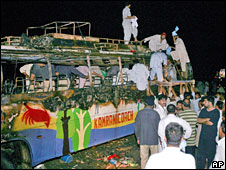 The burnt bus which crashed into a milk tanker in Pakistan