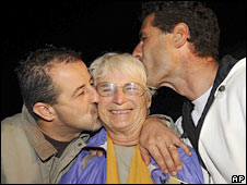 Mirella Degiuli, one of the five freed Italian tourists, is greeted by her sons in Turin