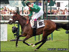 Zarkava ridden by jockey Christophe Soumillon