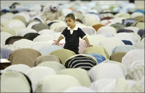 A child among Saudi men at morning prayers at the Imam Turki bin Abdullah mosque in Riyadh
