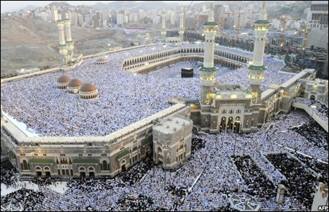 Hundreds of thousands of Muslims perform the early morning Eid al-Fitr prayers at the al-Haram Grand Mosque in Mecca.